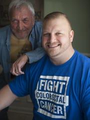 Colon cancer survivor Ed Yakacki III, 36, sits with