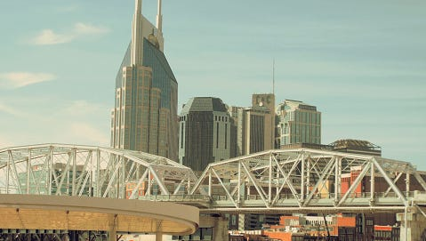 Low Angle View Of Bridge And Buildings In City