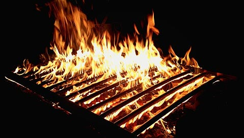 Burning Fire At Barbecue Grill