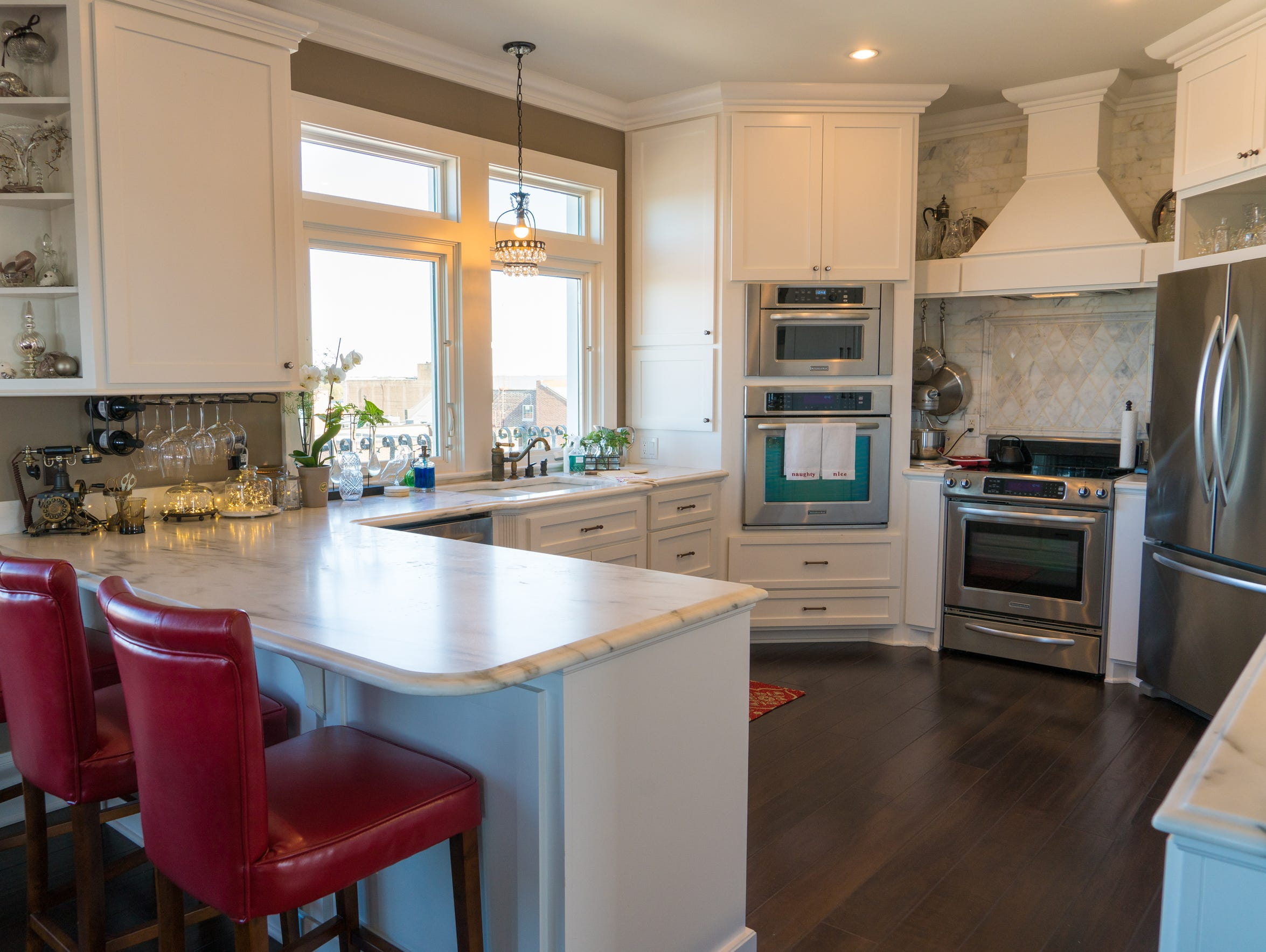 The kitchen has Calcutta Danby Marble counter tops