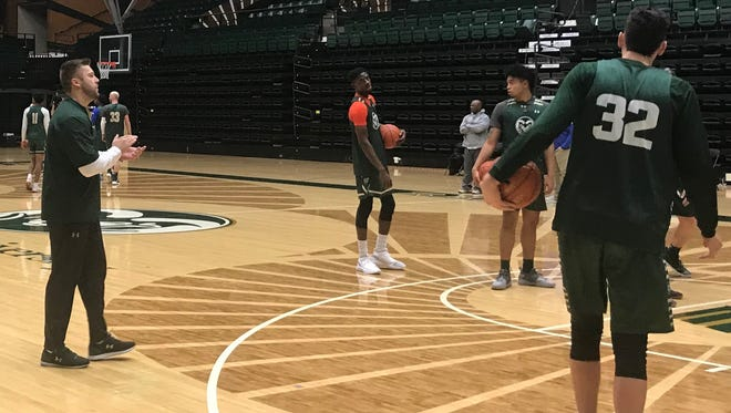 Jase Herl, CSU's interim coach, claps during practice Wednesday at Moby Arena. Herl, 30, is the Rams' second interim coach since head coach Larry Eustachy was placed on paid administrative leave Feb. 3.