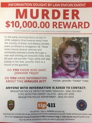 A flier announces a $10,000 reward for information