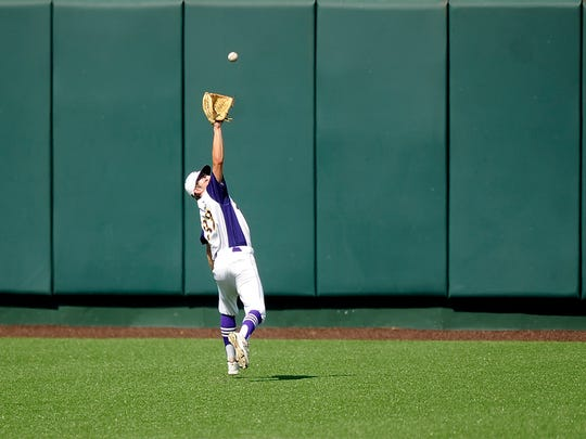Wylie center fielder Sam King (33) runs down a fly ball during the top of the fourth inning of the Bulldogs' 3-1 win over Texarkana Pleasant Grove in the Class 4A UIL state baseball semifinal on Wednesday, June 7, 2017, at Disch-Falk Field in Austin.