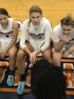 Benjamin senior forward Emma Laszewski, center, listens to coach Willie Shelton II during last Friday's 57-42 win over Oxbridge Academy. Laszewski, who finished with 13 points, 10 rebounds and four blocks, has committed to play Division I college basketball at Brown.