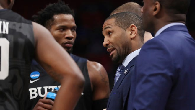 Butler head coach LaVall Jordan talks to th team during the first half of a second round game against Purdue in the NCAA college basketball tournament, Sunday, March 18, 2018, in Detroit.