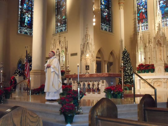 The late Bishop Ronald Herzog officiates at a mass for elected Alexandria officials in 2014.