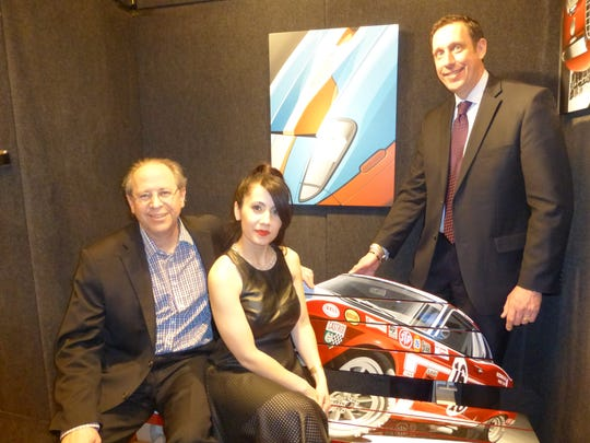 NAIAS Gallery Corporate Sponsors Tapper's of Novi, West Bloomfield and Troy team:  Steve Smith, fine watch buyer; Irene Yeldo, sales; and Paul Rujan, Somerset Tapper's store director; sold their fine jewelry and Shinola watches during the event.  The Tapper's team members are sitting on a custom, hand-painted acrylic bench by automotive artist David Chapple of Grand Blanc.