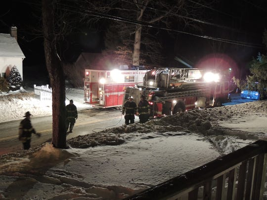 Firefighters at the scene of a house fire on Rymph Boulevard in Poughkeepsie