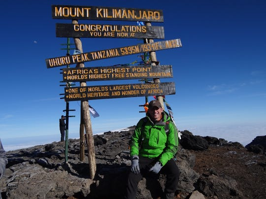 Tony Bucko, a Tigers fan, with his Old English D cap on August 12, 2014 at the summit of Mt. Kilimanjaro.