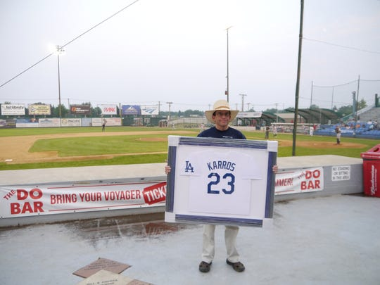 Keith Eakland displays his Eric Karros signed autographed jersey at Centene Stadium