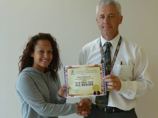 South Amboy High School junior Alissa Bikowski was named by the National Fastpitch Coaches to the all Northeast Region First Team as a catcher. She is pictured with Principal Patrick McCabe.