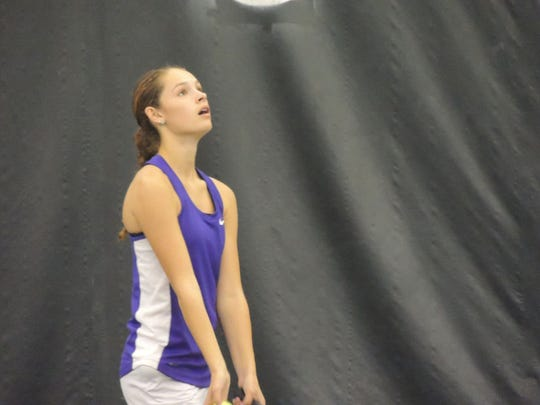 Lexington ninth grader Sylvia Goldsmith sets up for a serve during Saturday's Division II Girls Sectional Tournament in Lexington.