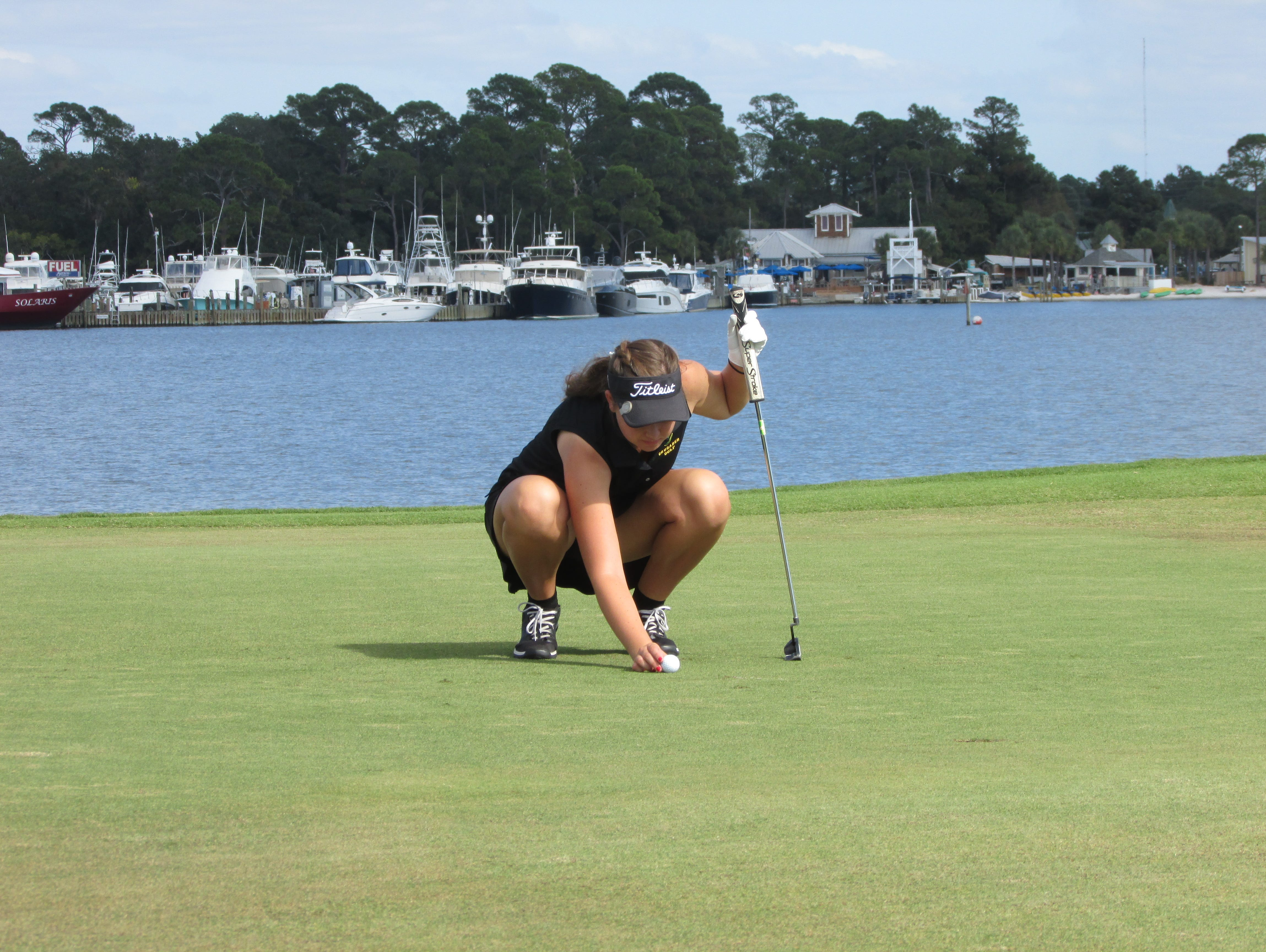 Abby Herrmann lines up putt on No. 14 at Links in Sandestin. She led Catholic to Region 1A girls title.