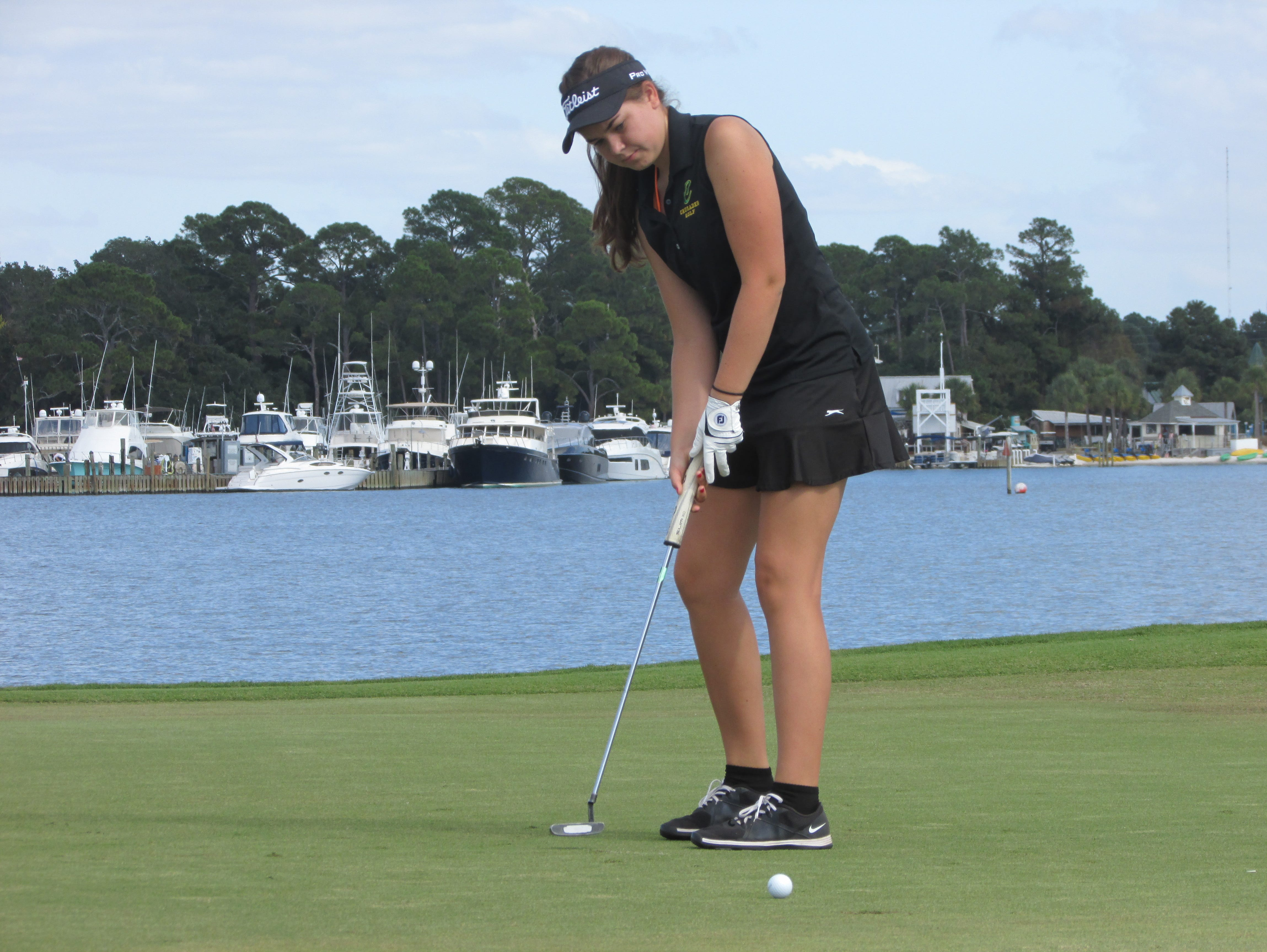 Abby Herrmann follows putt on No. 14 at The Links in Sandestin.