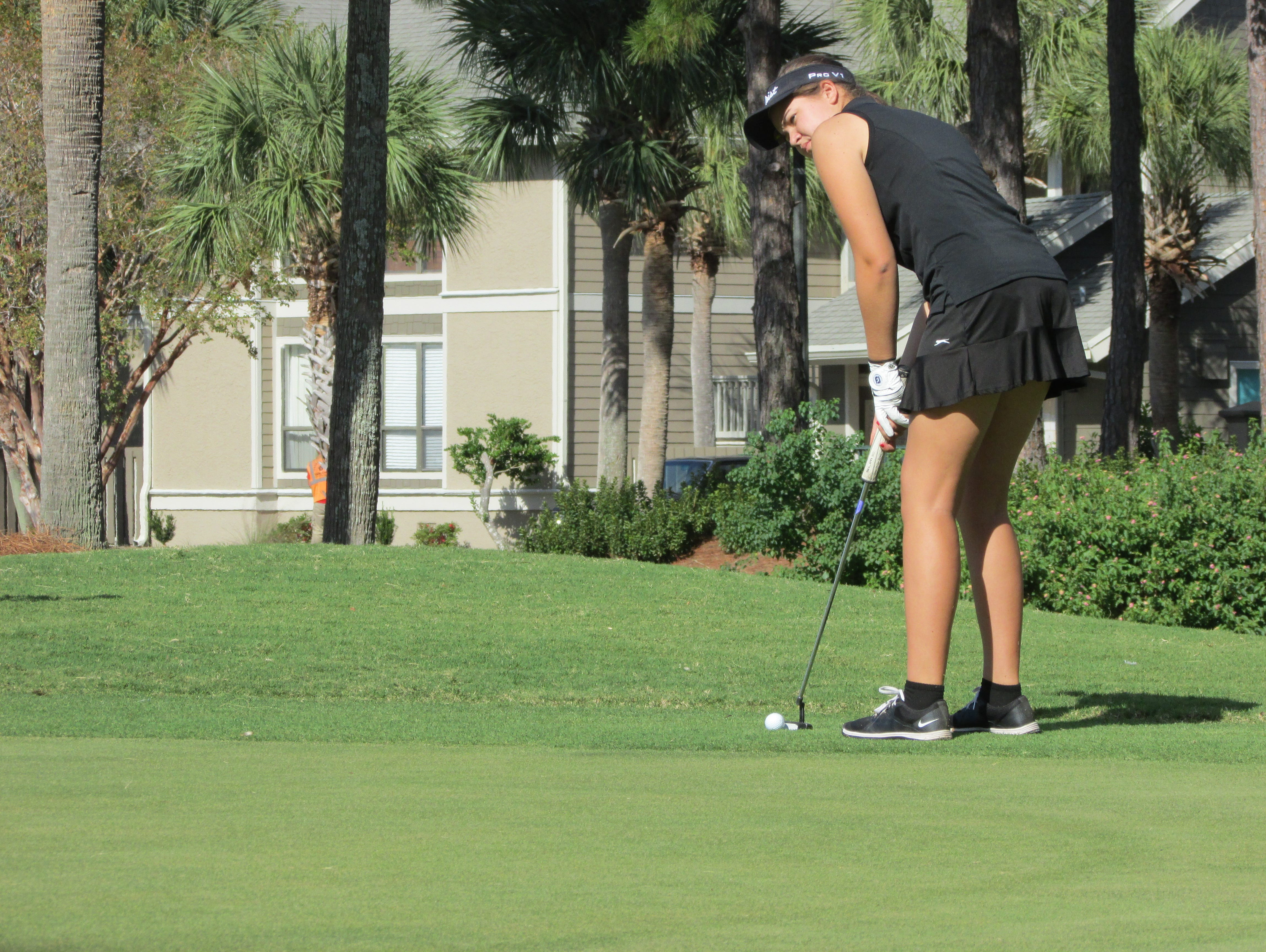 Abby Herrmann prepares for a putt on No. 16 at The Links in Sandestin.