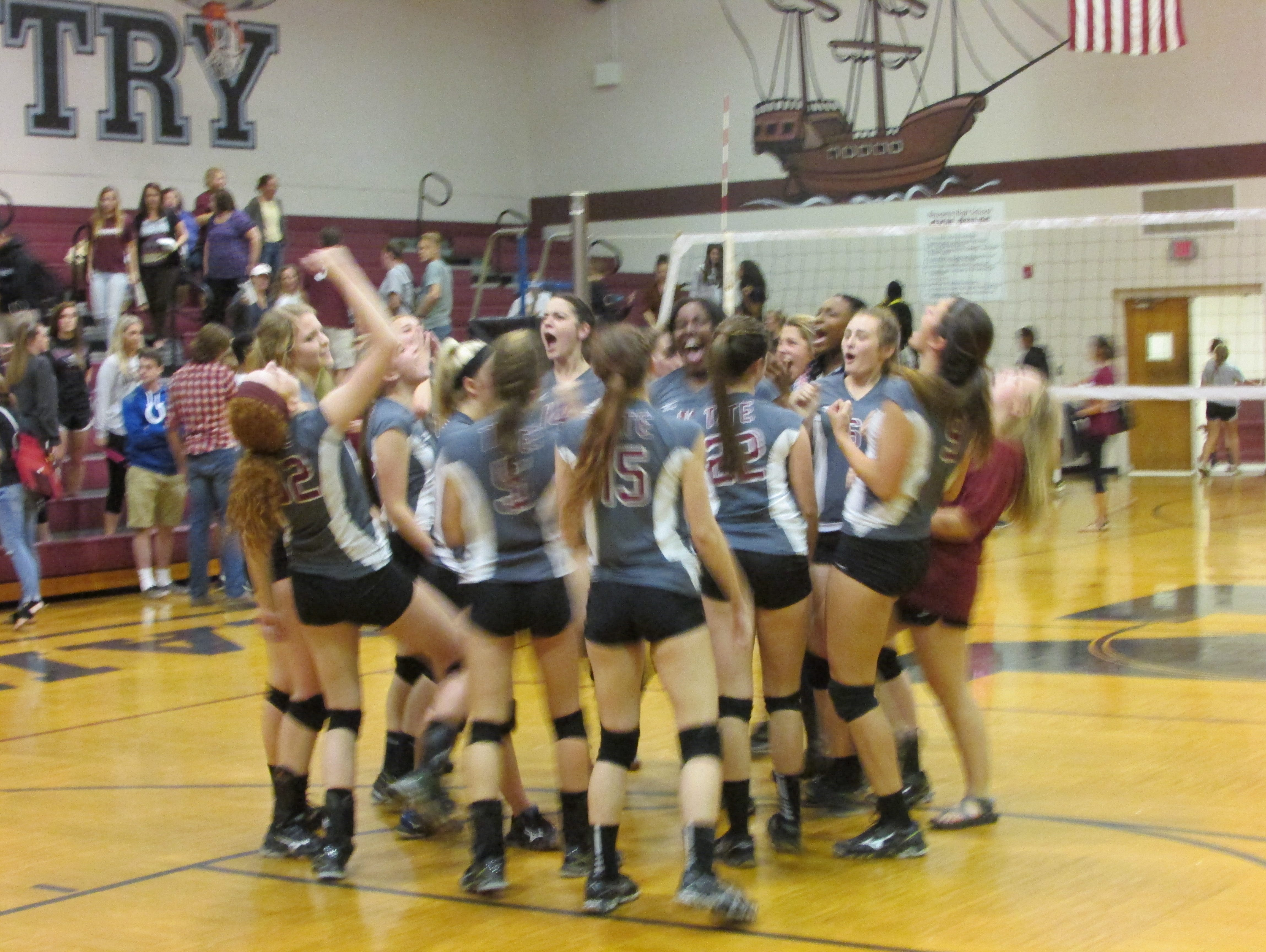 The Tate Aggies celebrate after their semifinal win against Navarre in the District 1-6A Tournament.