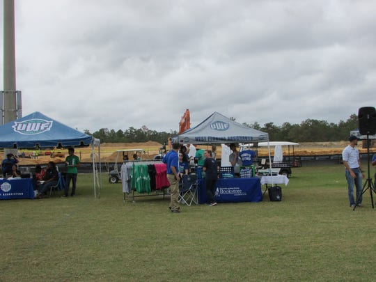 Behind the merchandise tents at UWF scrimmage is the