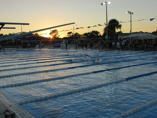 Spectacular sunset for final event  in boys 400 freestyle relay at Wednesday's Region 1-2A Championship at Panama City Aquatic Center.