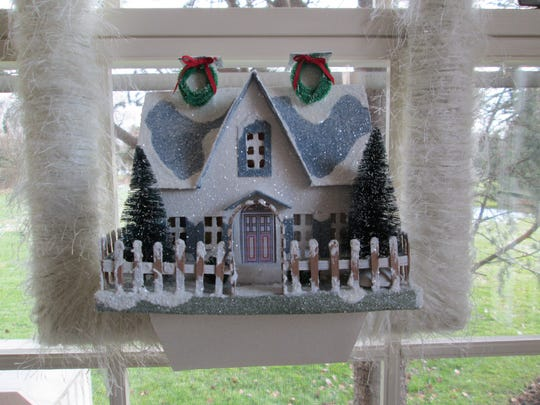Handmade picture framed house.