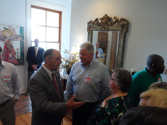 John Bel Edwards (left), who is in a Nov. 21 runoff for governor, talks to Sen.-elect Jay Luneau (center) and Luneau's mother, Myrna Luneau, on Thursday at a fundraiser for Edwards in Jay Luneau's Alexandria home.
