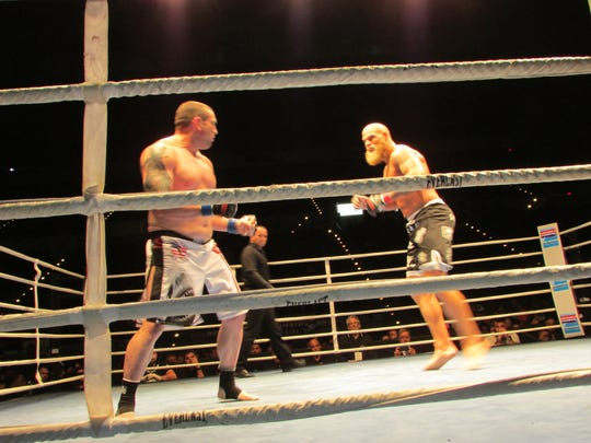 Chaz Morgan left and Dakota Merritt look for openings to land in Saturday's Island Fights 36 main event at Bay Center.