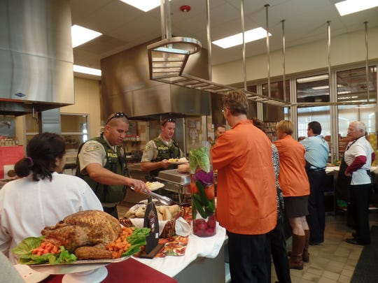 A turkey and all of the trimmings are presented by Desert Sands students and educators to members of the police, fire and sheriff's departments as a thank-you.