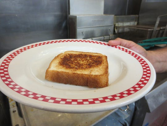 Texas toast, toasted with salted butter on the griddle.