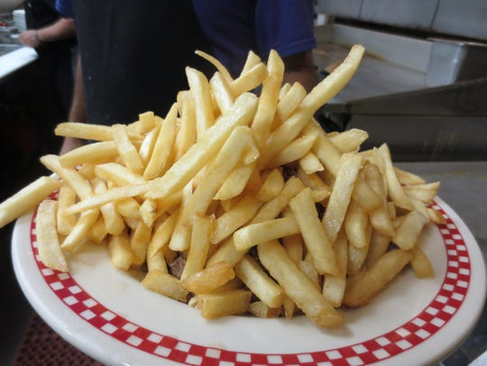 French fries top the Texas toast and steamed hamburger.
