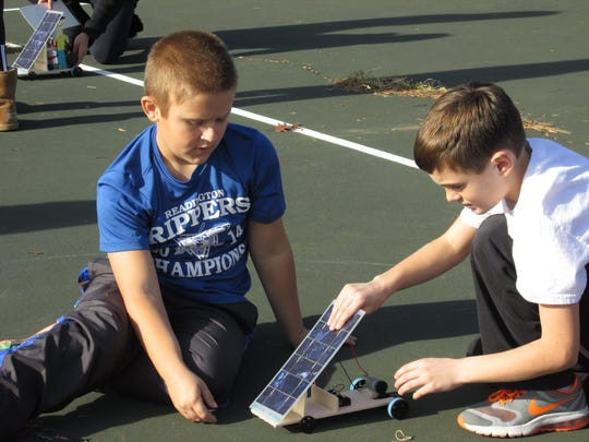 Readington Middle School students Colin DeRidder and Oliver Duryee get ready to test their model solar car