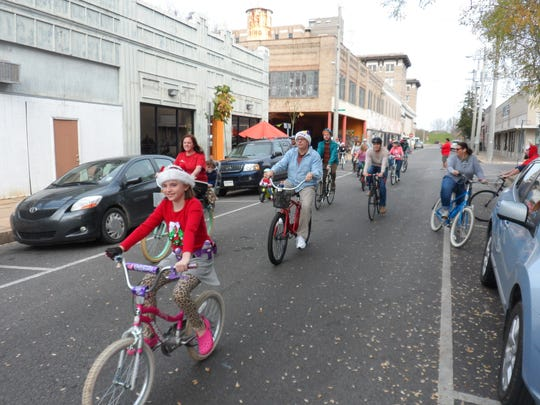 Riders take part in the  Christmas Cruiser Ride in downtown Alexandria. It was a fundraiser for the                Main Street Mission in Pineville.