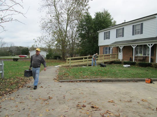 Members of the Lord Baltimore Lions Club build a wheelchair-accessible ramp at a Frankford home.