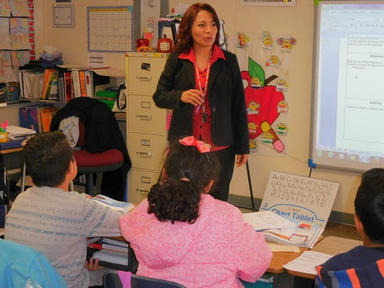 Arcelia Guillermo-Rios gathers her students into their