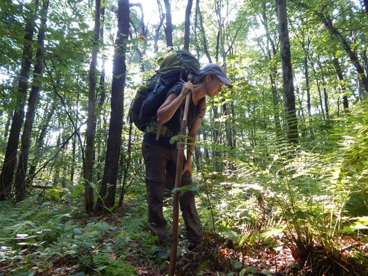 635895033863328406-Deb-looking-down-hiking.jpg