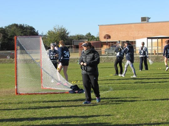 Gulf Breeze High lacrosse and head coach Carlee Costello are gearing up for the third round of the playoffs on Thursday at Oviedo Hagerty.