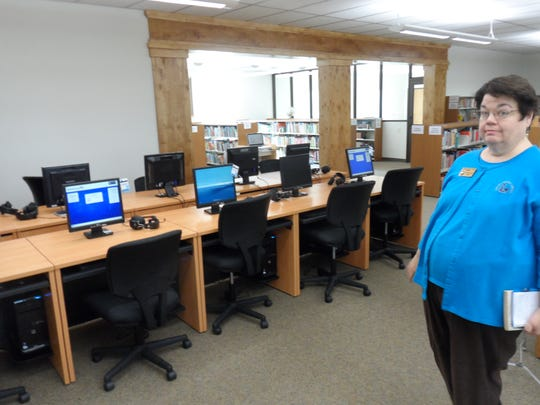 Rapides Parish Library Director Laura-Ellen Ayres stands near the new computer section at the J.L. Robertson Branch Library in Tioga. The branch reopened Monday after being closed for six weeks for work on an improvement project that doubled the building's size.