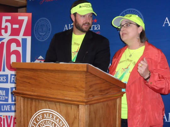 Dustin Matthews, chairman of the Louisiana Dragon Boat Races, and Catherine Pears,  executive director of the Alexandria Museum of Art, talk about the Dragon Boat Races at a press conference Monday. This year's races are set for May 7 on the Red River in downtown Alexandria.