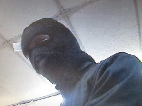 Lafayette Police Department released this image Tuesday of a suspected Village Pantry robber.