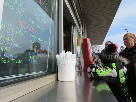 Blake Gruba waits for his ice cream at Belts' Soft