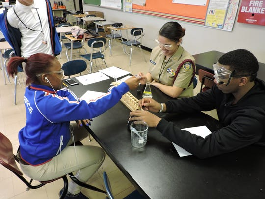 As Mylazia Caldwell, Mia Ortiz and Tavon Jones observe a double displacement reaction they discuss how to represent the reaction as a balanced chemical equation.