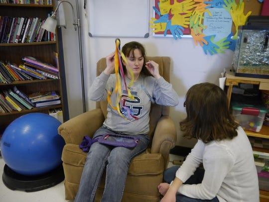Peer tutor Katelin Johnson works with Kylie Kopp at