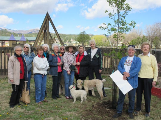 Members of the Lincoln County Garden Club and the Ruidoso Parks and Recreation Department lent a hand to plant a tree at Kids Konnection.