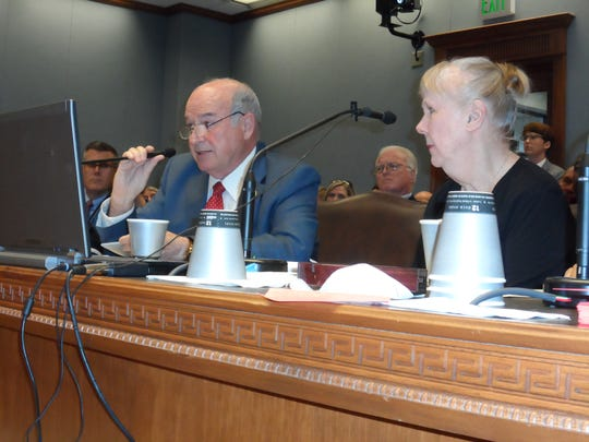 Rep. Terry Brown, I-Colfax, talks about House Bill 11 to ban open burning of explosives and munitions Wednesday during a House committee hearing. Listening at right is chemist Wilma Subra. The committee voted 9-8 to advance the bill.