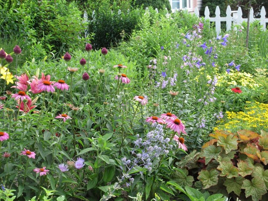 Lush and breezy, this English garden is one of the