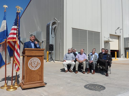 Alexandria Mayor Jacques Roy talks about the new generators at the power plant as members of the City Council and other city officials listen.