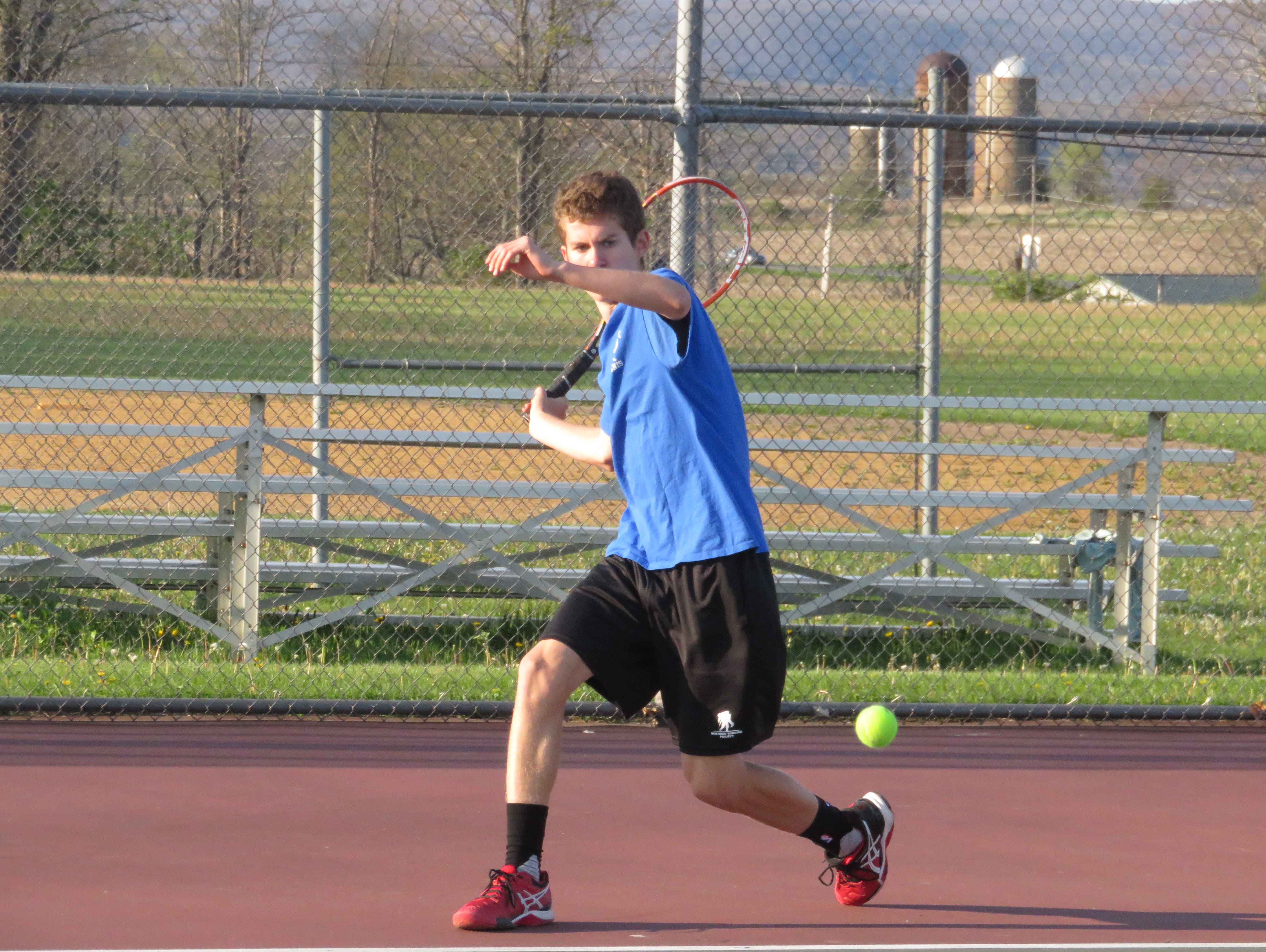 Millbrook High School boys tennis player Daniel Feigelson takes a swing on the court.