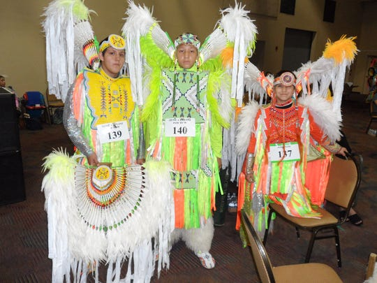 Colorful performers from the Ho-Chunk Nation of Wisconsin wait to join the procession for the Grand Entry prior to dance competitions.