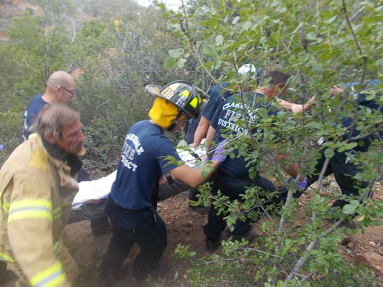 Fire crews work to free the 60-year-old man who was
