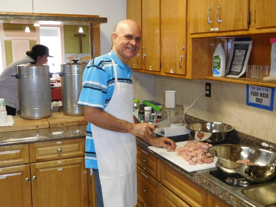 Jose Morais of Portugal prepares a meal for patrons