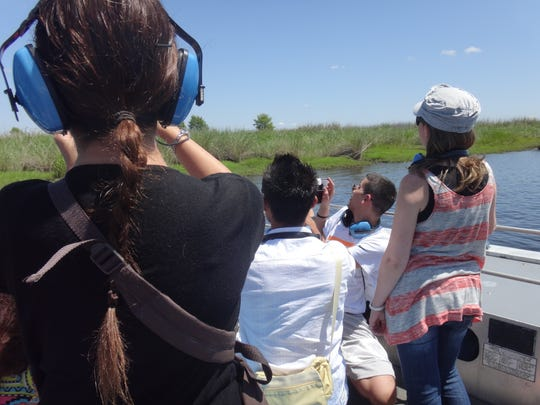 Tourists on an airboat ride coordinated by FunDay Tours