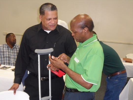 Radio talk show host Tony Brown (left) talks with state NAACP President Ernest Johnson prior to a Town Hall meeting hosted by the NAACP in Pineville.